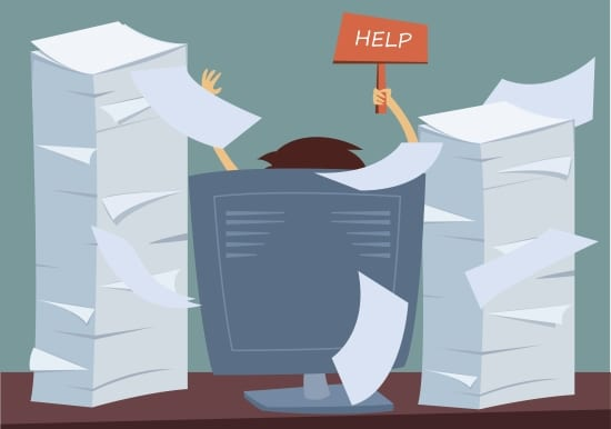 "a picture of a man at a desk covered with stacks of paperwork holding up a ""help"" sign representing how difficult event management can be without birdease systems management tools."